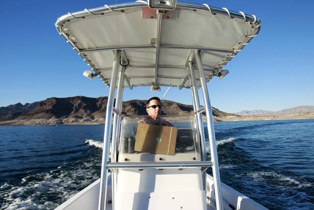 Ross Haley, a wildlife biologist with the National Park Service, pilots a boat on the Overton Arm of Lake Mead Wednesday, Jan. 15, 2014. The National Park Service conducted it's annual eagle count ...