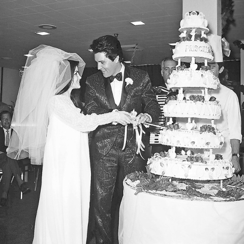 Priscilla Beaulieu Presley, left, and Elvis Presley cut the six-tiered cake shortly after their wedding at the Aladdin Hotel-Casino in Las Vegas on May 1, 1967.  (Don Zirkle/Las Vegas Review-Journal)