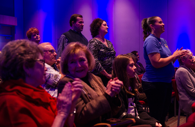 """Attendees clap during a town hall panel, titled """"Madam President,"""" held by Emily's List, at the Student Union at the University of Nevada, Las Vegas on Thursday, Jan. 30, 2014. The polit ..."""
