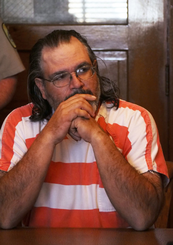 Murder suspect Coleman Ward sits quietly during his arraignment in Justice of the Peace Juanita Colvin's courtroom in the Esmeralda County Courthouse in Goldfield, Nev., Tuesday, Dec. 31, 2013. Wa ...