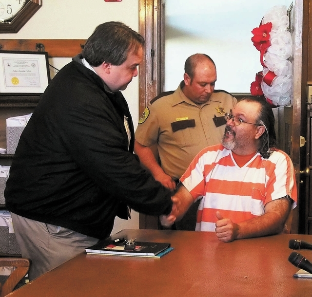 Murder suspect Coleman Ward, right, meets his public defender Chris Arabia during his arraignment in Justice of the Peace Juanita Colvin's courtroom in the Esmeralda County Courthouse in Goldfield ...
