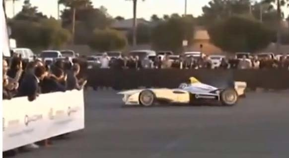 This image from video shows an electric race car that showed up in Las Vegas as the Consumer Electronics Show began on Monday. The car was operated on a makeshift track behind Mandalay Bay. See th ...