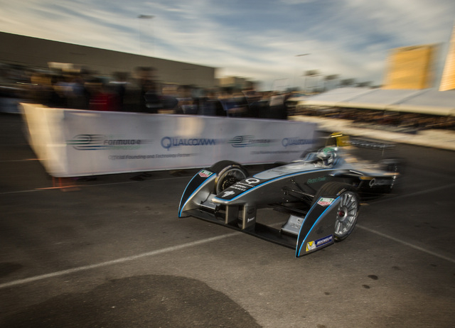 Former Formula One driver Lucas di Grassi demonstrates the new Formula E car Monday in the Mandalay Bay parking lot during its unveiling. A new FIA-sanctioned racing championship for electric race ...