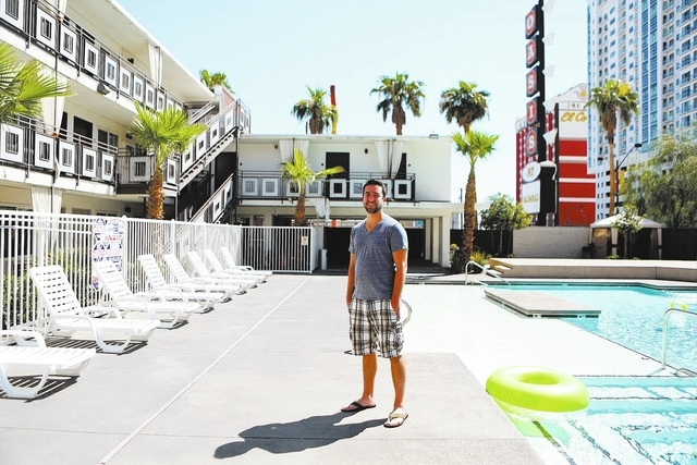 Jake McCrea stands by the pool outside his apartment at the Gold Spike on Sept. 14 in Las Vegas. McCrea was one of the first Zappos employees to move into the transformed Gold Spike. Downtown Las  ...