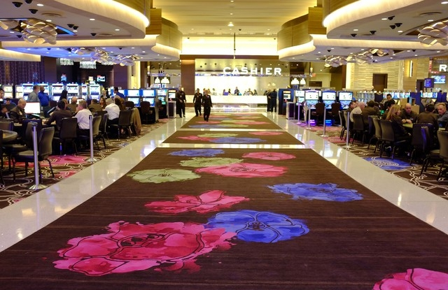 In this Oct. 29 photo, patterns inspired by Sonoma County flowers are shown on a custom-woven carpet inside the Graton Resort and Casino in Rohnert Park, Calif. (AP Photo/Eric Risberg)