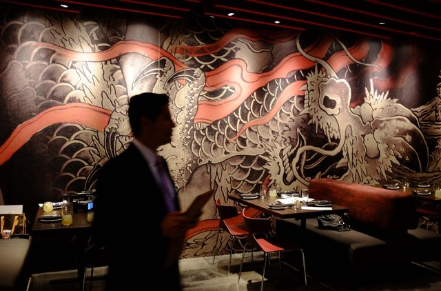 In this Oct. 29 photo, a mural created by a tattoo artist is shown on a wall of the M.Y. China restaurant at the Graton Resort and Casino in Rohnert Park, Calif. (AP Photo/Eric Risberg)