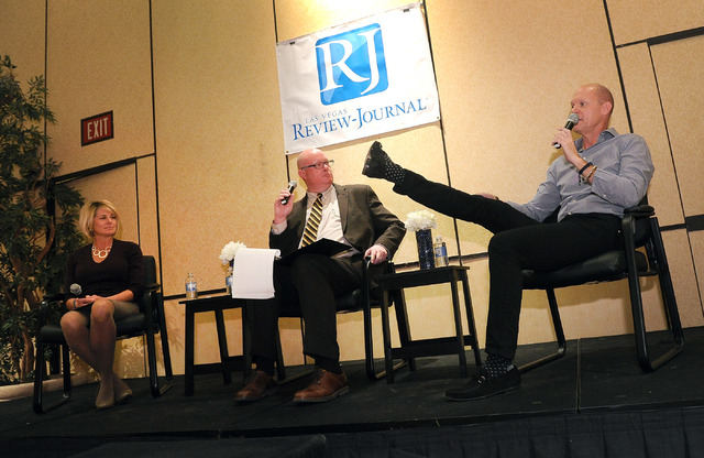 Tom Skancke, right, president and CEO of Las Vegas Global Economic Alliance makes a point with his foot as Tina Quigley, left, general manager of the Regional Transportation Commission and moderat ...