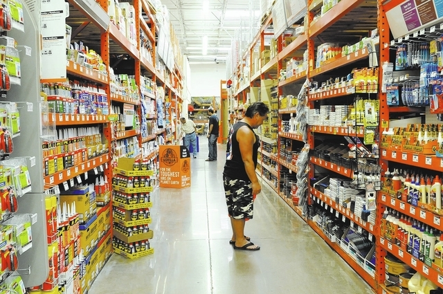 Renwick Adriano from Hawaii, right, looks for refinishing items at Home Depot, Tuesday, March 15, 2011. He is helping his parents, who live in Las Vegas, work on their home. (File, Jerry Henkel/La ...