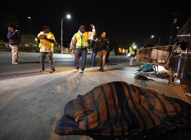 Volunteers perform a count on Main Street during the Southern Nevada Homeless Census urban in Las Vegas on Wednesday. (Justin Yurkanin/Las Vegas Review-Journal)