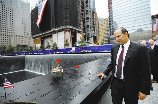 Howard Lutnick, Chairman and Chief Executive Officer of Cantor Fitzgerald, that lost 658 employees in the Sept. 11, 2001 attack on the World Trade Center, looks at names inscribed at one of the re ...