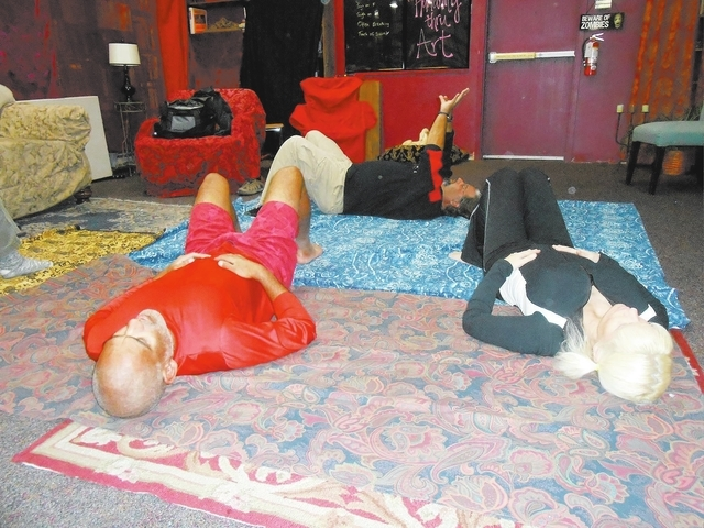 Attendees lie on the floor to facilitate deep breathing exercises Dec. 3 at Dead Poet Books, 937 S. Rainbow Blvd., led by Adam Littman, back row. Littman is founder of Humanity Thru Art, an organi ...
