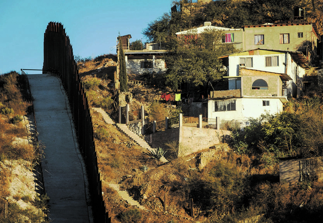 The United States, left, and Mexican international border fence at Nogales as seen Tuesday Nov. 19, 2013. Nevada and Arizona lawmakers and businessmen are supporting a proposal create a new inters ...