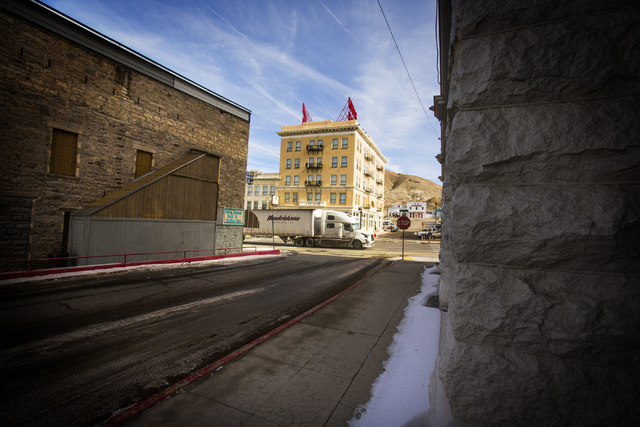 A truck passes the  Mizpah Hotel on U.S. 95, in  Tonopah, Nev. on Tuesday, Dec. 17, 2013. The hotel was built in 1907. Transportation officials are proposing Interstate 11 to connect Las Vegas and ...