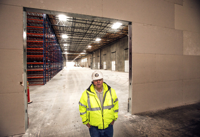 Dean Haymore director of Storey County Community Development, inside a warehouse under construction at the Tahoe-Reno Industrial Center beside Interstate 80 on Thursday, Dec. 19, 2013. The  107,00 ...