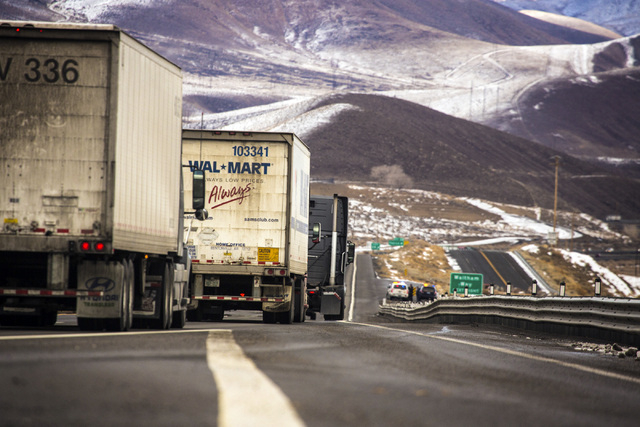 Trucks travel eastbound on I-80 near the Tahoe-Reno Industrial Center in Storey County on Thursday, Dec. 19, 2013. The  107,000-acre former ranch property  is located about 10 miles east of Reno a ...