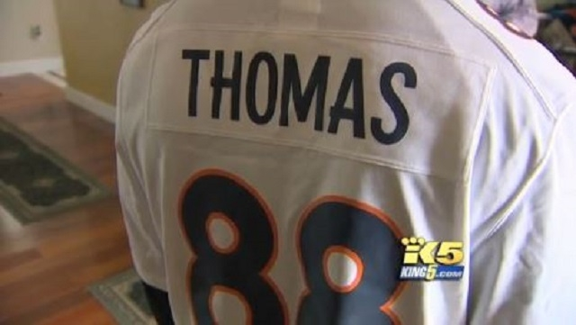 Nathaniel Wentz, 17, wears the Broncos jersey that got him sent home from his Seattle employer on Sunday. (KING 5)