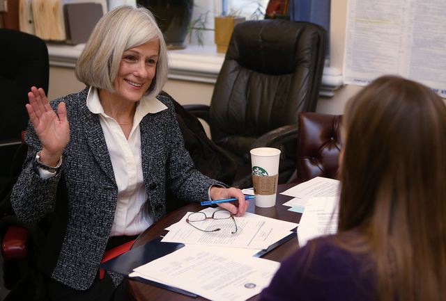 Nevada Supreme Court Justice Kristina Pickering files for re-election at the Secretary of State's office in Carson City on Monday. Andrea Allen, with the Secretary of State's office, is at right.  ...