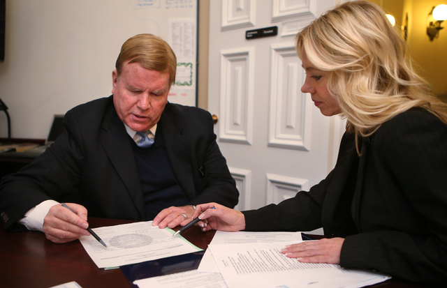 Nevada Supreme Court Chief Justice Mark Gibbons files for re-election with Elections Division Officer Shelly Capurro at the Secretary of State's office in Carson City on Monday. (Cathleen Allison/ ...