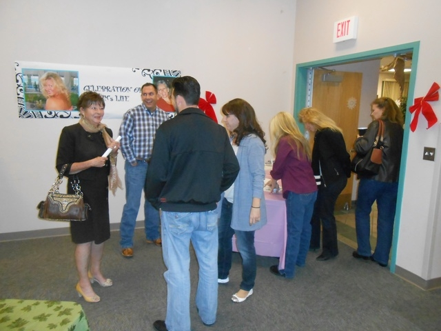 People sign in at an evening to celebrate what would have been Kim Bush's 50th birthday. Bush, who was Clark County Commissioner Larry Brown's liaison, was well known in the community as someone w ...