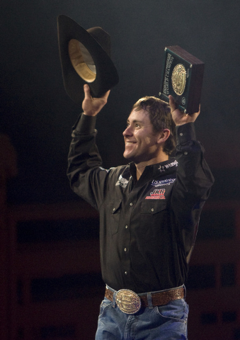 K.M. CANNON/LAS VEGAS REVIEW-JOURNAL Trevor Brazile holds up the all-around world championship buckle during the final night of the National Finals Rodeo at the Thomas & Mack Center in Las Vegas T ...