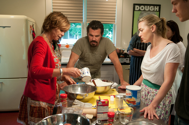 """Author Joyce Maynard, left, demonstrates her pie-baking skills for Josh Brolin and Kate Winslet on the set of """"Labor Day."""" (Dale Robinette/Paramount)"""