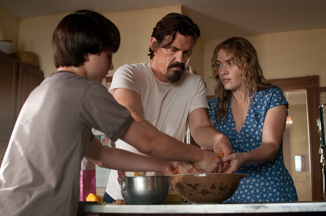 """From left, Gattlin Griffith is Henry, Josh Brolin is Frank and Kate Winslet is Adele in """"Labor Day."""" (Dale Robinette/Paramount)"""