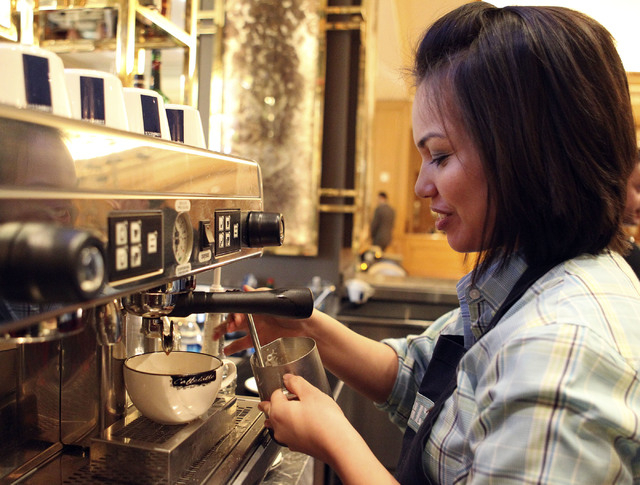 Wendy Larson, a barista at Press at the Four Seasons, prepares a latte. She's been creating latte art for about two years using a Lavazza Blue machine. If you see a person creating latte art, sh ...