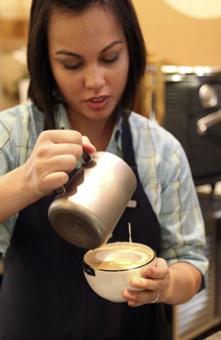 Wendy Larson, a barista at the Four Seasons, prepares a latte that she will adorn with art made from the milk added to the finished product. (Jerry Henkel/Las Vegas Review-Journal)
