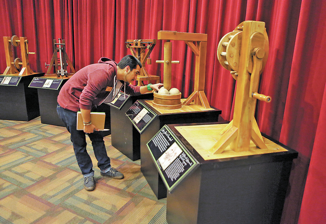 """Tito Garcia looks at an interactive display shown at """"Leonardo Da Vinci: Machines in Motion"""" exhibit at Springs Preserve Thursday, Jan. 23, 2014, in Las Vegas. The exhibit, which is loca ..."""