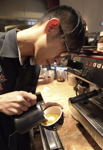Barista Lawrence Chung creates art in cups of latte at Leone Cafe in Tivoli Village in Las Vegas, Thursday, Jan. 9, 2014. (Jerry Henkel/Las Vegas Review-Journal)