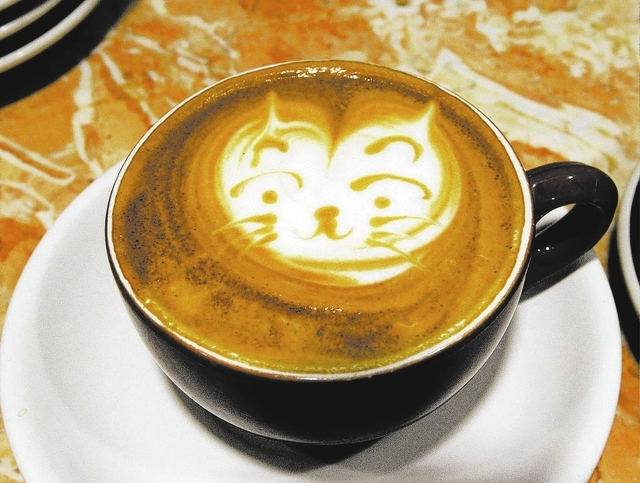 Barista Lawrence Chung, of Las Vegas, creates art in cups of latte at Leone Cafe in Tivoli Village. (Jerry Henkel/Las Vegas Review-Journal)
