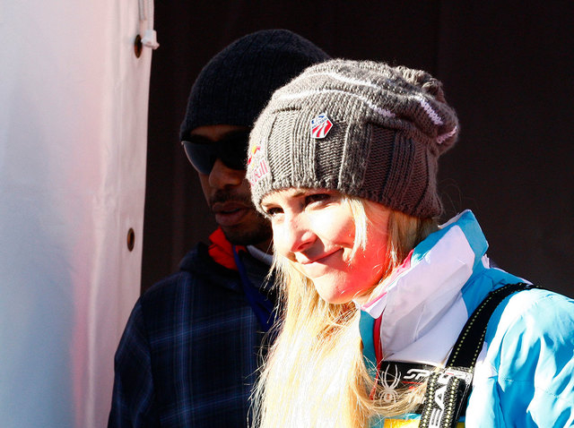 Lindsey Vonn is flanked by her boyfriend, Tiger Woods, as she leaves after an alpine ski, women's World Cup downhill in Val D'Isere, France on Dec. 21. Vonn is going to skip the Sochi Olympics bec ...