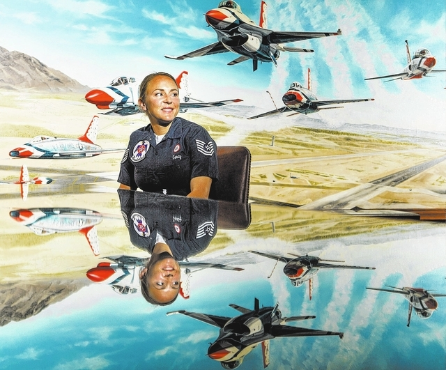 Air Force Tech Sgt. Amanda Geray  sits in front of a mural in the Thunderbird hangar conference room at Nellis Air Force Base on Wednesday, Jan. 15, 2014. She becomes the first female line chief i ...