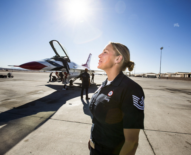 Air Force Tech Sgt. Amanda Geray  stands on the tarmac at  Nellis Air Force Base on Wednesday, Jan. 15, 2014. She becomes the first female line chief in team's 61-year storied history. (Jeff Schei ...