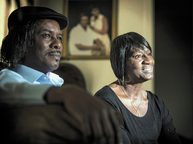 Lorrine Rodgers,right,  her husband Nelson  sit in their   Las Vegas living room on Friday, Jan. 3, 2014. They have been married for 43 years. She had breast cancer that came back in her lungs, bu ...