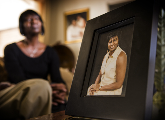 Lorrine Rodgers  sits in her Las Vegas living room on Friday, Jan. 3, 2014. On the left is a photo of her taken four years ago before she got breast cancer.The cancer came back in her lungs, but a ...