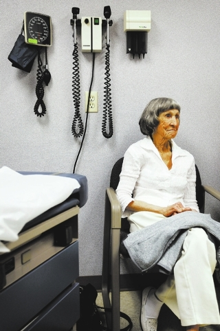 Recovering cancer patient Rosemary Rathbun listens to her oncologist Dr. Fadi Braiteh (not pictured) during an examination at the Comprehensive Cancer Centers of Nevada in Las Vegas on Friday, Jan ...