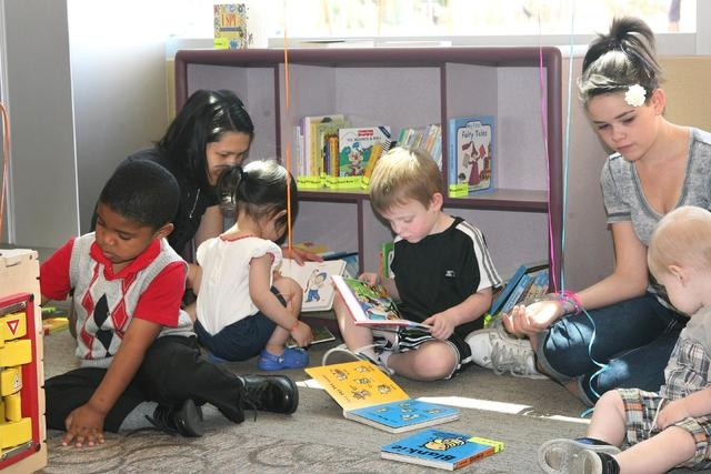 Children read and play in the children's section at the Windmill Library, 7060 W. Windmill Lane, in Las Vegas. The library plans to offer a series of five Family Place Parent-Child Workshops for c ...