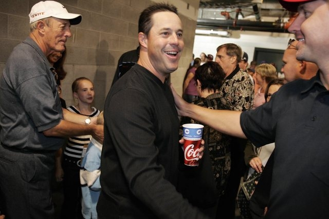 SPORTS--Greg Maddux of the Chicago Cubs is congratulated after leaving the locker room after he won his 300th game Saturday, Aug. 7, 2004 in San Francisco. photo by John Locher