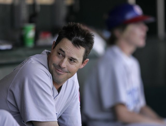 SPORTS--Greg Maddux of the Chicago Cubs smiles while sitting in the dugout during his 300th won game Saturday, Aug. 7, 2004 in San Francisco. photo by John Locher