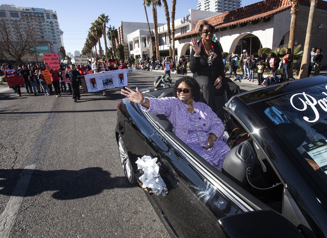 Ruby Duncan, a longtime advocate for civil rights and welfare rights in Las Vegas, waves during the Martin Luther King Jr. Day Parade on 4th Street in downtown Las Vegas , Monday, Jan. 20, 2014.   ...