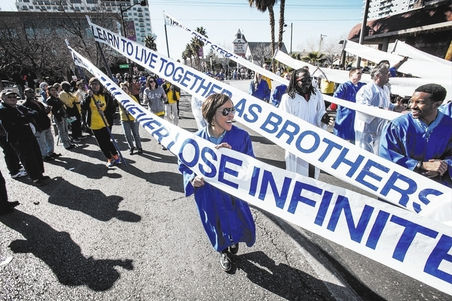 Bette Gaines Snyder marches with the MGM Resorts International during the Martin Luther King parade on 4th Street in downtown Las Vegas, Monday, Jan. 20, 2014. She served as one of the grand marsh ...