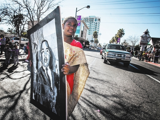 Priscilla Graves with 100 Academy of Excellence carries a portrait during the Martin Luther King parade on 4th Street in downtown Las Vegas, Monday, Jan. 20, 2014.  The 32nd annual parade lasted 4 ...