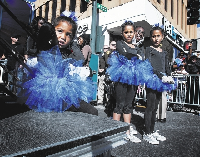 Jazmine Noble, left, with Blue Jays dance troupe covers her ears while a motorcycle group passes the viewing stand during the Martin Luther King parade on 4th Street in downtown Las Vegas, Monday, ...