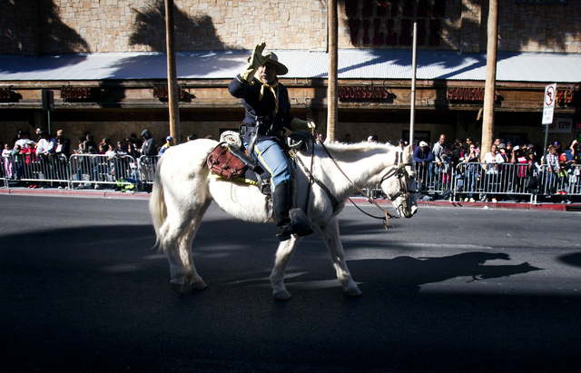 Buffalo Soldier Keith Hill, a retired Air Force veteran, waves during the Martin Luther King Jr. Day Parade on 4th Street in downtown Las Vegas, Monday, Jan. 20, 2014. The 32nd annual parade laste ...