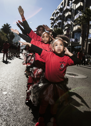 Miah Wallace,right,  4, with the Vegas Most Wanted troupe performs during the Martin Luther King Jr. Day Parade on 4th Street in downtown Las Vegas, Monday, Jan. 20, 2014.The 32nd annual parade la ...