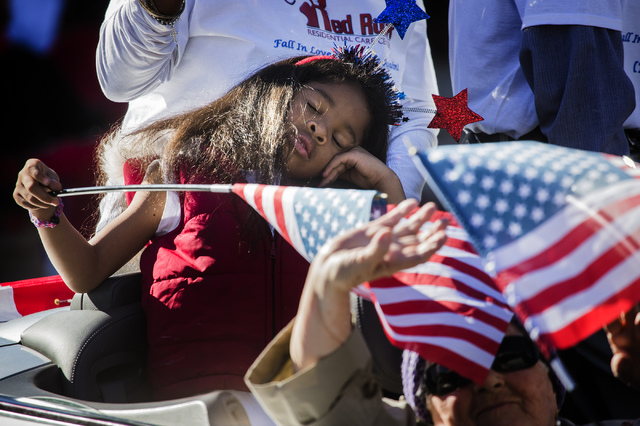 Jacqueline Cobb, 7, closes her eyes while sitting  a car sponsored by Red Rock Residential Care Center during the Martin Luther King Jr. Day Parade on 4th Street in downtown Las Vegas, Monday, Jan ...