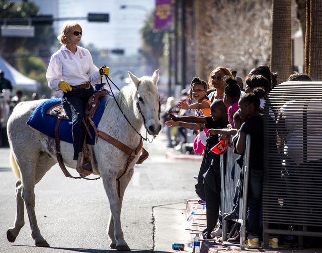 Judge Carolyn Ellsworth rides her horse during the Martin Luther King Jr. Day Parade on 4th Street in downtown Las Vegas, Monday, Jan. 20, 2014, The 32nd annual parade lasted 4 hours. (Jeff Scheid ...