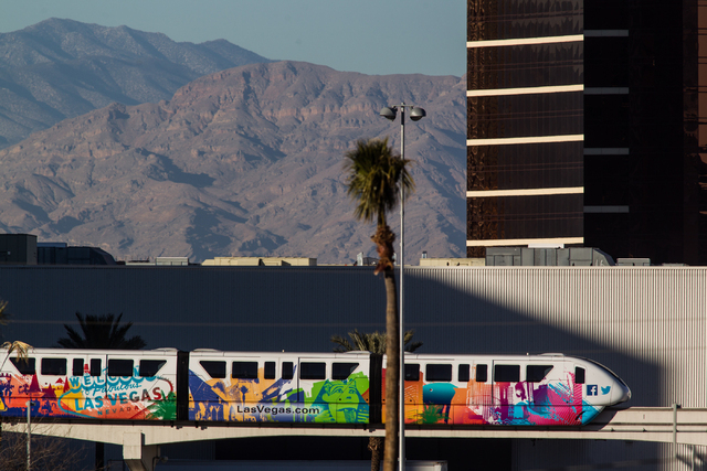 The Las Vegas Monorail heads northbound from the Harrahs Las Vegas and The Quad station towards the Las Vegas Convention Center station on Wednesday. (Chase Stevens/Las Vegas Review-Journal)
