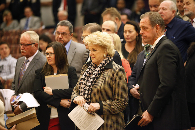 North Las Vegas Mayor John Lee, right, and Las Vegas Mayor Carolyn Goodman, left of Lee, wait to speak with others before the Clark County Commission in Las Vegas Tuesday, Jan. 21, 2014. The commi ...